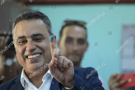 Stock Image of Presidential candidate Mehdi Jomaa shows his ink-stained finger after casting his ballot for presidential election at a polling station in Tunis