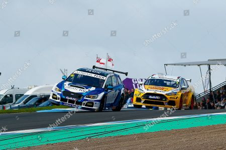 Aiden MOFFAT Laser Tools Racing & Tom CHILTON Team Shredded Wheat Racing with Gallagher leaving Duffers Dip on 2 wheels during Round 23 of the Kwikfit British Touring Car Championship at Knockhill Racing Circuit, Dunfermline