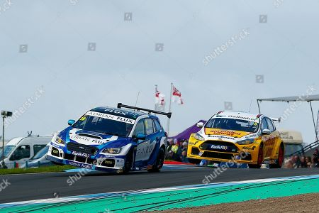 Stock Photo of Aiden MOFFAT Laser Tools Racing & Tom CHILTON Team Shredded Wheat Racing with Gallagher leaving Duffers Dip on 2 wheels during Round 23 of the Kwikfit British Touring Car Championship at Knockhill Racing Circuit, Dunfermline