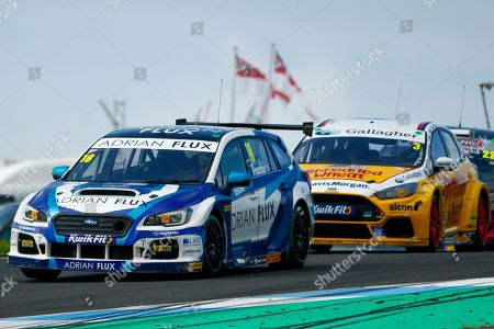 Stock Picture of Senna PROCTOR Adrian Flux Subaru Racing & Tom CHILTON Team Shredded Wheat Racing with Gallagher during Round 23 of the Kwikfit British Touring Car Championship at Knockhill Racing Circuit, Dunfermline