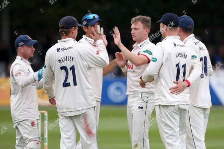 Sam Cook of Essex celebrates with his team mates after taking the wicket of Jamie Smith during Essex CCC vs Surrey CCC, Specsavers County Championship Division 1 Cricket at The Cloudfm County Ground on 16th September 2019