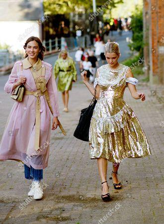 Alexa Chung with Pixie Geldof arriving for Simone Rocha fashion show, Alexander Palace, London.