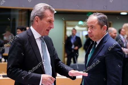 EU Budget Commissioner, German Gunther Oettinger (L) chats with Secretary of State for European Affairs, Polish Konrad Szymanski during the European General Affairs Council in Brussels, Belgium, 16 September 2019. The meeting will focus on rule of law in Poland and Hungary.