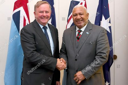 Australian Opposition Leader Anthony Albanese (L) and Prime Minister of Fiji Josaia Voreqe Bainimarama shake hands ahead of a bilateral meeting at Parliament House in Canberra, Australian Capital Territory, Australia, 16 September 2019.