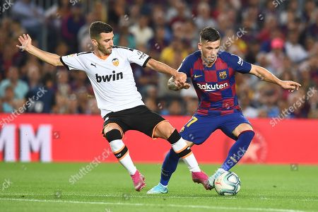Stock Photo of Carlos Perez of FC Barcelona and Jose Luis Gaya of Valencia CF
