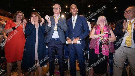 Jo Swinson, Brian Paddick, Chuka Umunna in the conference hall after UMUNNA delivers his conference speech. The Liberal Democrat Party Conference at the Bournemouth International Centre.