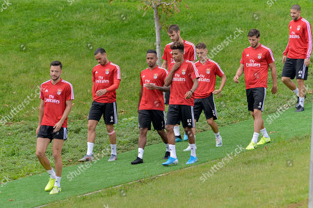 Benfica's players Jardel Vieira (L), Ruben Dias (C) and Gedson Fernandes (R) during a training session in view of upcoming UEFA Champions League Group G against RB Leipzig, in Seixal, near Lisbon, Portugal, 16 September 2019.