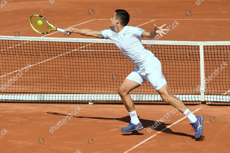Stock Photo of Attila Balazs of Hungary plays against Illya Marchenko of Ukraine during the decisive fifth match of the Tennis Davis Cup Group I, Europe/Africa 1st round tie Hungary vs Ukraine in Budapest, Hungary, 16 September 2019. Hungary won 3-2.