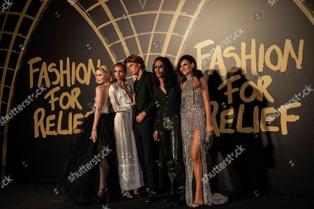 Stella Maxwell, Jordan Barrett, Luka Sabbat and guests pose for photographers upon arrival at the Fashion For Relief charity event in central London