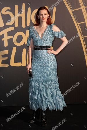 Karen Elson poses for photographers upon arrival at the Fashion For Relief charity event in central London