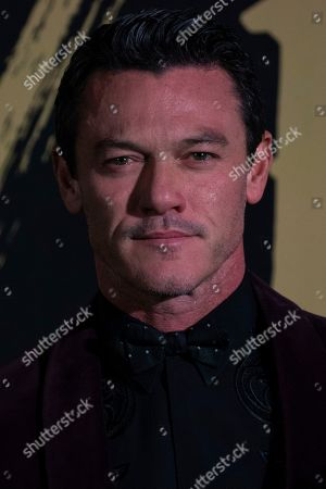 Luke Evans poses for photographers upon arrival at the Fashion For Relief charity event in central London