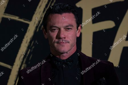 Stock Photo of Luke Evans poses for photographers upon arrival at the Fashion For Relief charity event in central London