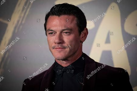 Stock Image of Luke Evans poses for photographers upon arrival at the Fashion For Relief charity event in central London