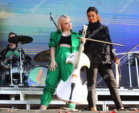Stock Image of Grace Chatto and Stephanie Benedetti of British Electro Pop band Clean Bandit on stage at BBC Radio 2 Live in Hyde Park event, Hyde Park, London