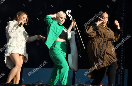Stock Picture of Yasmin Green, Grace Chatto and Kirsten Joy of British Electro Pop band Clean Bandit perform live on stage at the BBC Radio 2 Live in Hyde Park, London.