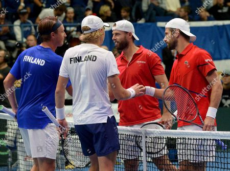 Henri Kontinen and Emil Ruusuvuori of Finland and Oliver Marac and Jurgen Melzer of Austria after Tennis Davis Cup doubles match