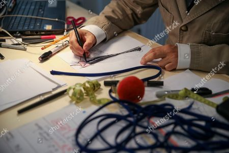 Designer Herve Pierre sketches a dress design for Emmy-nominated actress Jessica Hecht to wear at the Creative Arts Emmy Awards, at Atelier Caito for Herve Pierre in New York