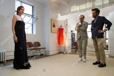 Jessica Hecht, Herve Pierre, Nicolas Caito. Designer Herve Pierre, center, and Nicolas Caito, right, fit Emmy-nominated actress Jessica Hecht with a dress for her to wear at the Creative Arts Emmy Awards, at Atelier Caito for Herve Pierre in New York
