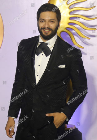 Stock Image of Bollywood actor Ali Fazal poses as he arrives to attend International Indian Film Academy (IIFA) Rocks, a pre-awards event of the 20th IIFA awards in Mumbai, India,. The 20th IFFA awards ceremony will be held in Mumbai on Sept. 18