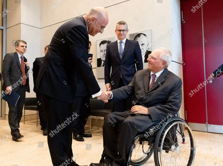President of the German Parliament Bundestag Wolfgang Schaeuble (R) shakes hands with Foreign Minister of Greece Nikos Dendias (2L) at the Reichstag building in Berlin, Germany, 16 September 2019. Greek Foreign Minister Dendias and President of Bundestag Schaeuble met for bilateral talks.