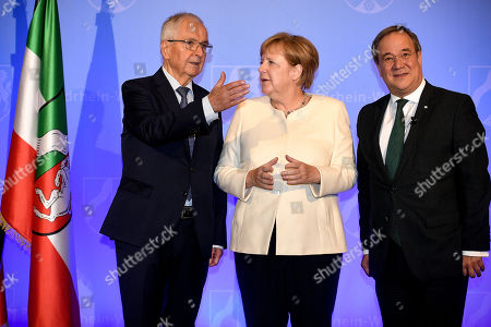 (L-R) Professor Dr. Klaus Toepfer, German Chancellor Angela Merkel and Prime Minister of North Rhine-Westphalia Armin Laschet arrive for the North Rhine-Westphalian State Prize awarding ceremony at the World Conference Center in Bonn, Germany, 16 September 2019. Toepfer, the former Federal Environment Minister, long-time Executive Director of the United Nations Environment Programme and Undersecretary-General of the UN, has been awarded the State Prize, the highest distinction of the State of North Rhine-Westphalia.