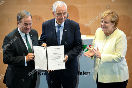 Professor Dr. Klaus Toepfer (C) receives the North Rhine-Westphalian State Prize from Prime Minister of North Rhine-Westphalia Armin Laschet (L) and German Chancellor Angela Merkel (R) during the awarding ceremony at the World Conference Center in Bonn, Germany, 16 September 2019. Toepfer, the former Federal Environment Minister, long-time Executive Director of the United Nations Environment Programme and Undersecretary-General of the UN, has been awarded the State Prize, the highest distinction of the State of North Rhine-Westphalia.