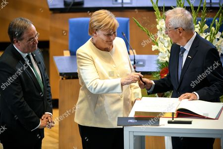 Professor Dr. Klaus Toepfer (R) receives the North Rhine-Westphalian State Prize from Prime Minister of North Rhine-Westphalia Armin Laschet (L) and German Chancellor Angela Merkel (C) during the awarding ceremony at the World Conference Center in Bonn, Germany, 16 September 2019. Toepfer, the former Federal Environment Minister, long-time Executive Director of the United Nations Environment Programme and Undersecretary-General of the UN, has been awarded the State Prize, the highest distinction of the State of North Rhine-Westphalia.