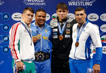 Stock Photo of Zhan Beleniuk, Viktor Lorincz, Denis Maksymilian Kudla, Rustam Assakalov. Winners of the men's Greco-Roman 87kg category of the Wrestling World Championships, from left: Viktor Lorincz of Hungary, silver medal, Zhan Beleniuk of Ukraine, gold medal, Denis Maksymilian Kudla of Germany and Rustam Assakalov of Uzbekistan, bronze medal pose with medals in Nur-Sultan, Kazakhstan