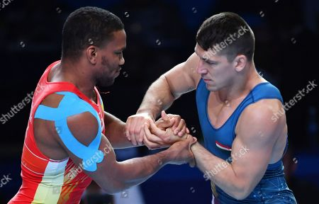 Denis Maksymilian Kudla, Mikalai Stadub, Zhan Beleniuk, Viktor Lorincz. Zhan Beleniuk of Ukraine, left, and Viktor Lorincz of Hungary compete in the gold medal match of the men's Greco-Roman 87kg category of the Wrestling World Championships in Nur-Sultan, Kazakhstan
