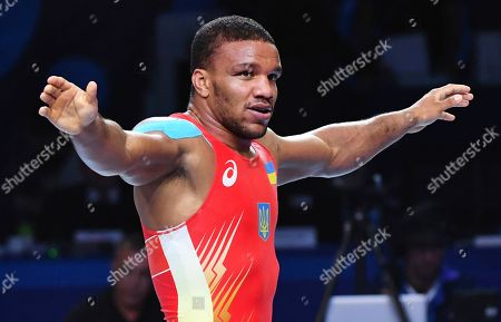 Denis Maksymilian Kudla, Mikalai Stadub, Zhan Beleniuk. Zhan Beleniuk of Ukraine celebrates his victory over Viktor Lorincz of Hungary in the gold medal match of the men's Greco-Roman 87kg category of the Wrestling World Championships in Nur-Sultan, Kazakhstan