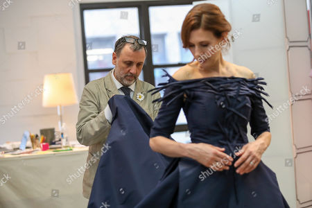 Herve Pierre, Jessica Hecht. Designer Herve Pierre, left, fits actress Jessica Hecht, for dresses for her to wear at the Creative Arts Emmys, at Atelier Caito for Herve Pierre in New York