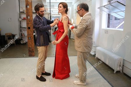 Jessica Hecht, Herve Pierre, Nicolas Caito. Designer Herve Pierre, right, and Nicolas Caito fit actress Jessica Hecht, for dresses for her to wear at the Creative Arts Emmys, at Atelier Caito for Herve Pierre in New York