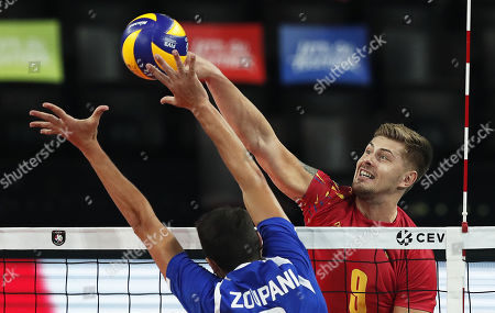 Stock Photo of Nikos Zoupani (L) of Greece in action against Robert Adrian Aciobanitei (R) of Romania during the EuroVolley Men 2019 group A match between Romania and Greece in Montpellier, France, 16 September 2019.