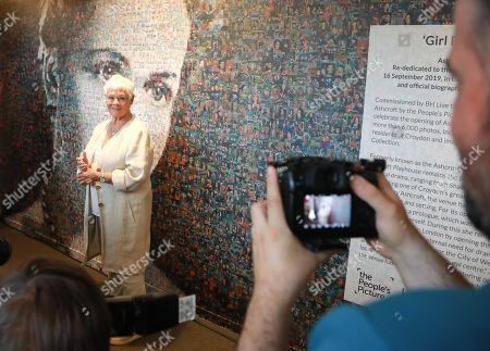 Stock Photo of Judi Dench with the 6,000 photos portraits of Dame Peggy Ashcroft.