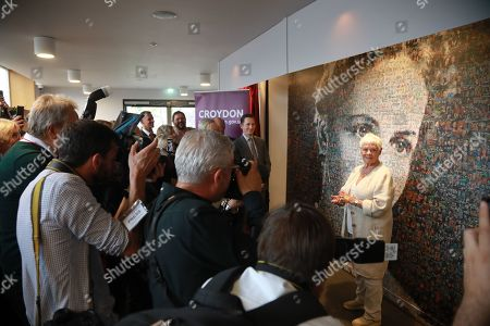 Judi Dench with the 6,000 photos portraits of Dame Peggy Ashcroft.