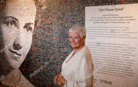 Stock Picture of Judi Dench with the 6,000 photos portraits of Dame Peggy Ashcroft.