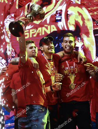 Stock Photo of Spain's national basketball team players (L-R) Xavi Rabaseda, Juancho and Willy Hernangomez during the celebration after winning the FIBA basketball World Cup at Colon Square in Madrid, Spain, 16 September 2019. Spain won the FIBA Basketball World Cup final against Argentina in Beijing, China on 15 September 2019.
