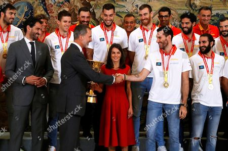 Spain's King Felipe VI (C-L) and Queen Letizia (C) meet Spanish national basketball team players, including captain Rudy Fernandez (C-R), during a reception at Zarzuela Palace in Madrid, Spain, 16 September 2019. Spain won the FIBA Basketball World Cup final against Argentina in Beijing, China on 15 September 2019.