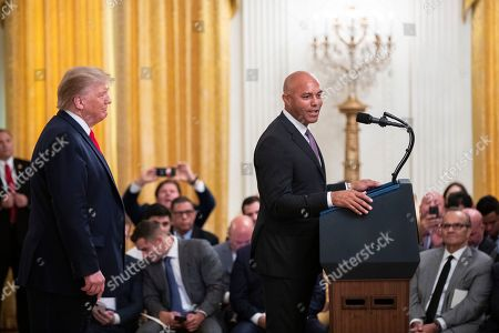 Donald Trump, Mariano Rivera, Joe Torre. President Donald Trump listens to former New York Yankees baseball pitcher Mariano Rivera speaks during ceremony presenting the Presidential Medal of Freedom to Rivera, in the East Room of the White House, in Washington. Former Yankees manager Joe Torre is seated back right