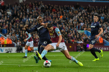 16th September 2019, Villa Park, Birmingham, England ; Premier League Football, Aston Villa vs West Ham ; John McGinn (07) of Aston Villa fights for the ball with Angelo Ogbonna of West Ham Credit: Gareth Dalley/News Images English Football League images are subject to DataCo Licence