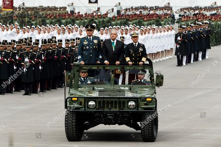 Mexican President Andres Manuel Lopez Obrador (C) participates next to the National Defense Secretary Luis Crescencio Sandoval (L) and the Marine Secretary Jose Rafael Ojeda Duran (R) during the 209th anniversary of the Independence of Mexico, in Mexico City, Mexico, 16 September 2019. The president of Mexico, Andrés Manuel Lopez Obrador, attended the military parade for the 209th anniversary of the Grito de la Independencia, the first with a contingent of the National Guard.