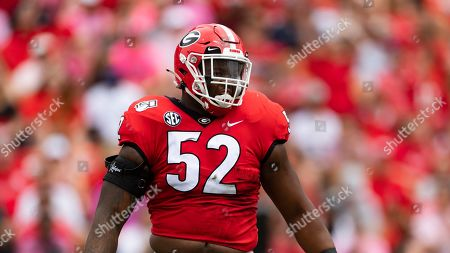 Georgia defensive lineman Tyler Clark looks over the Arkansas State offensive linup during an NCAA football game on in Athens, Ga