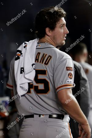 San Francisco Giants relief pitcher Derek Holland (45) looks from the dugout after pitching during the sixth inning of a baseball game against the Miami Marlins, in Miami