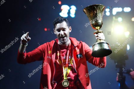 Spain's captain Rudy Fernandez holds the trophy as he celebrates with team mates from Spain's national basketball team in front of fans in Madrid, Spain, . Spain has captured its second World Cup championship, defeating Argentina 95-75 on Sunday
