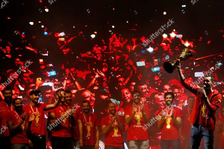 Spain's captain Rudy Fernandez, right, holds the trophy as he celebrates with team mates from Spain's national basketball team in front of fans in Madrid, Spain, . Spain has captured its second World Cup championship, defeating Argentina 95-75 on Sunday