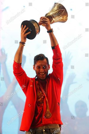Spain's captain Rudy Fernandez holds the trophy as he celebrates with teammates from Spain's national basketball team in front of fans in Madrid, Spain, . Spain has captured its second World Cup championship, defeating Argentina 95-75 on Sunday