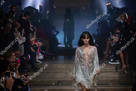 Model Genevieve Potgieter wears a creation by Julien Macdonald at the Spring/Summer 2020 fashion week runway show in London