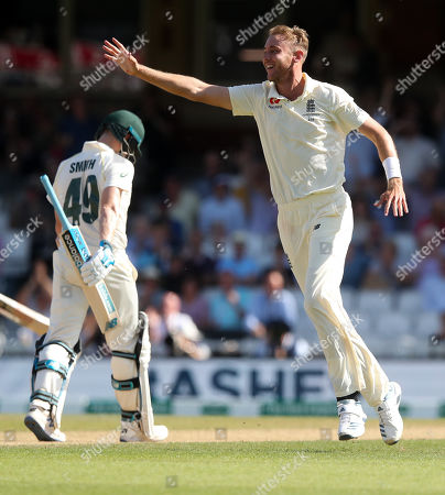 Stock Image of England's Stuart Broad celebrates the wicket of Steve Smith of Australia (L) out for 23 runs caught England's Ben Stokes
