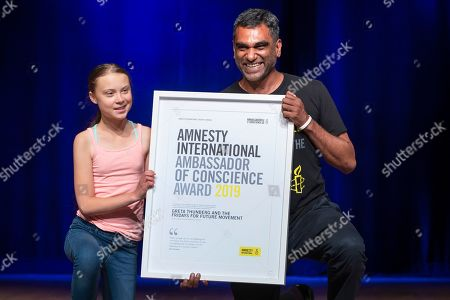 Swedish climate activist Greta Thunberg (L) poses with Amnesty International Secretary General Kumi Naidoo (R) after Thunberg was awarded Amnesty International's Ambassador of Conscience award at George Washington University in Washington, DC, USA, 16 September 2019. Thunberg is scheduled to attend the United Nations Climate Action Summit in New York City.