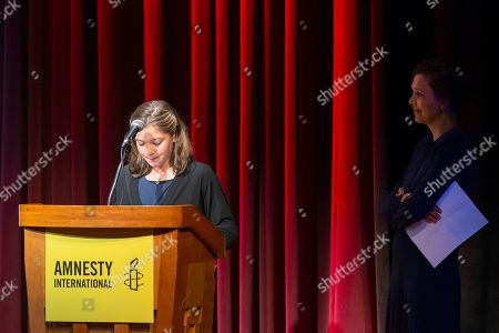 US actress and producer Maggie Gyllenhaal (R) listens to her daughter Ramona Sarsgaard (L) speak during a program to award Swedish climate activist Greta Thunberg with Amnesty International's Ambassador of Conscience award at George Washington University in Washington, DC, USA, 16 September 2019. Thunberg is scheduled to attend the United Nations Climate Action Summit in New York City.